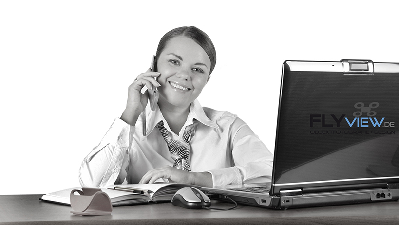 beautiful business woman speaks on the phone on a workplace